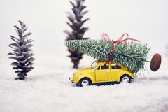 Christmas tree on yellow toy car with snow, Merry Christmas conc. Christmas tree on yellow toy car with snow royalty free stock images