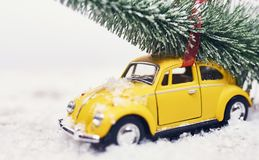 Christmas tree on yellow toy car with snow, Merry Christmas conc. Christmas tree on yellow toy car with snow stock image