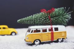 Christmas tree on yellow toy car with snow, Merry Christmas conc. Christmas tree on yellow toy car with snow stock images