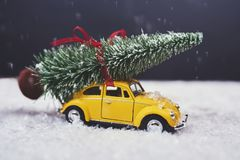 Christmas tree on yellow toy car with snow, Merry Christmas conc. Christmas tree on yellow toy car with snow stock photos