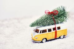 Christmas tree on yellow toy car with snow, Merry Christmas conc. Christmas tree on yellow toy car with snow royalty free stock photo