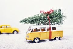 Christmas tree on yellow toy car with snow, Merry Christmas conc. Christmas tree on yellow toy car with snow royalty free stock image