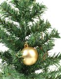 Christmas tree and yellow toy. Royalty Free Stock Photography