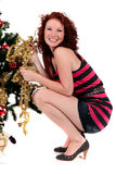 Christmas tree young happy woman Royalty Free Stock Image