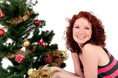 Christmas tree, young happy woman. Royalty Free Stock Photos