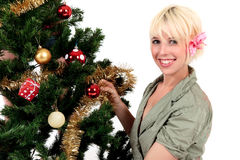 Christmas tree young happy woman Royalty Free Stock Images