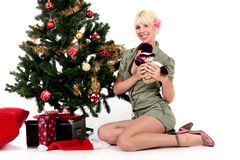 Christmas tree, young happy woman Stock Photo