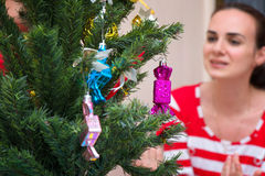 Christmas tree and young woman Royalty Free Stock Image