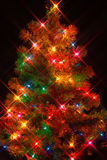 Christmas Tree2. Christmas tree on black background with starburst lighting effect Royalty Free Stock Photography