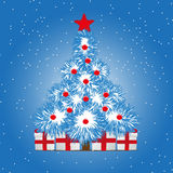 Christmas treer on snowy blue background Stock Images