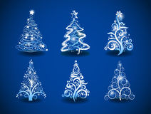 Christmas trees. Six modern christmas trees on a blue background Royalty Free Stock Photos