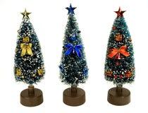 Christmas trees. Three little Christmas trees, isolated on white Stock Photos