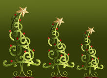 Christmas trees. Contemporary Christmas trees on green Royalty Free Stock Images
