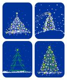 Christmas trees. Four stylized fur-trees on a dark blue background Stock Photography