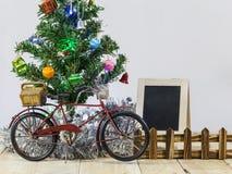 Christmas trees adorned with beautiful bike and blackboard. Stock Photo