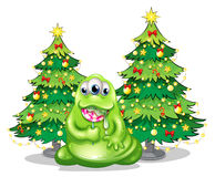 Christmas trees at the back of the monster with a lollipop Stock Photo