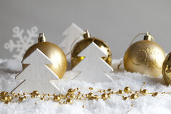 Christmas trees and baubles Stock Images