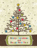 Christmas trees on beige background with label Royalty Free Stock Photography