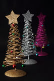 Christmas trees on black background Stock Images
