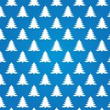 Christmas trees on blue background. New year seamless texture Royalty Free Illustration