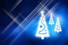 Christmas trees with blue background. Stock Image