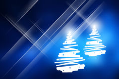 Christmas trees with blue background. Royalty Free Stock Image
