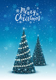 Christmas trees on blue background. Christmas trees on shiny blue background Royalty Free Stock Images