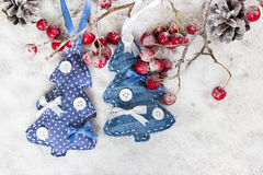 Christmas trees on a branch with berries Stock Image