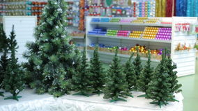 Christmas Trees and decorations at store. Christmas Trees, garlands, bulbs and toys at supermarket stock video