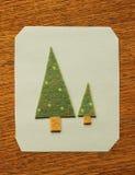 Christmas trees. Design card christmas trees on wood texture Royalty Free Stock Photos