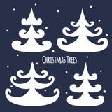 Christmas trees. Four white christmas trees and snow Stock Photo