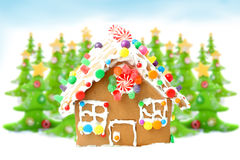 Christmas trees and gingerbread house royalty free stock photography
