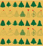 Christmas Trees. Green Christmas Trees over golden background with red ornaments Stock Photo