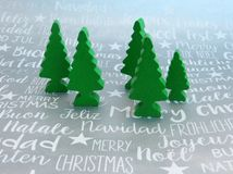Christmas trees green wooden toy with a silver international text christmas background royalty free stock photos