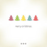 Christmas trees. Greeting card with Christmas trees in paper cutout style Stock Image