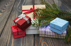 Christmas trees with heap of gift boxes Stock Photos