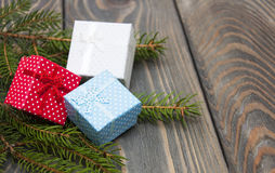 Christmas trees with heap of gift boxes Stock Photography