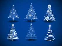 Christmas trees. Hi-tech and programing theme Christmas trees on a blue background Royalty Free Stock Images