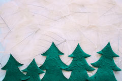 Christmas trees with leaves texture on background Royalty Free Stock Photos