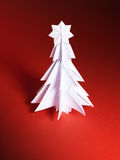 Christmas trees made of paper on red background Stock Image