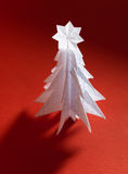 Christmas trees made of paper on red background Royalty Free Stock Photography