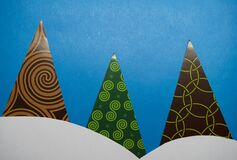 Christmas trees made of paper triangles