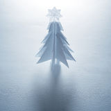 Christmas trees made of paper on white background. Stock Photo
