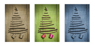 Christmas trees made of wooden branches with gifts. Triptych in brown, green and blue. Stock Photos