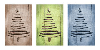 Christmas trees made of wooden branches. Triptych in brown, green and blue. Stock Photography