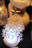 Christmas trees. Plastic Christmas trees with a gold star Stock Photography