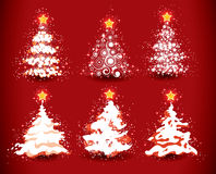 Christmas trees on red Stock Images