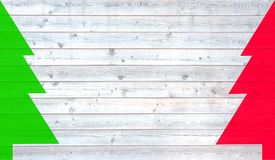 Christmas trees red and green with wooden planks. Light grey wooden planks background with red and green christmas tree Stock Photo