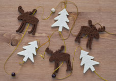 Christmas trees and a reindeer Stock Photos