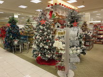 Christmas trees for sale. Decorated christmas tree ornaments display for sale in a mall royalty free stock photo